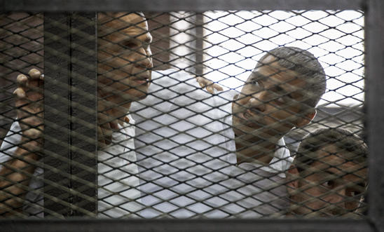 Al-Jazeera journalists (L-R) Peter Greste, Mohamed Fadel Fahmy and Baher Mohamed