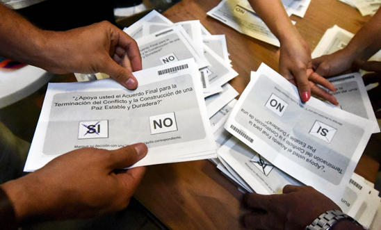 Electoral officials count votes at a polling station in Cali, Colombia