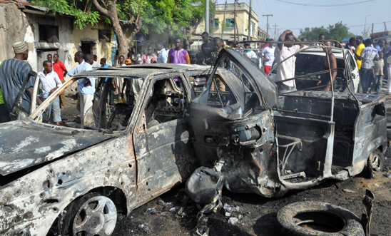 Burnt vehicles after a bomb attack in Maiduguri
