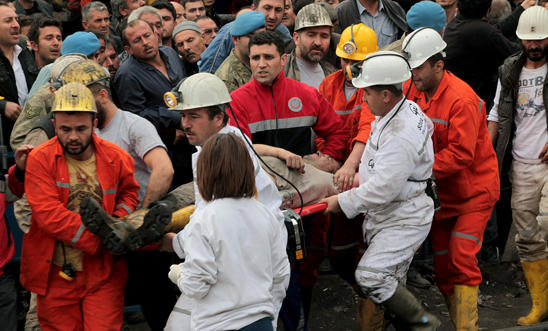 Rescue workers carry a miner on May 14, 2014 in Soma, Turkey