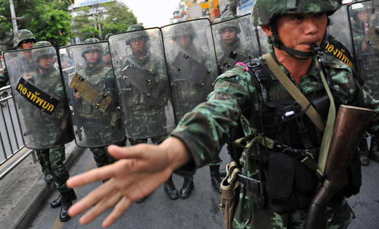 Thai army soldiers stand guard on a city centre street in Bangkok