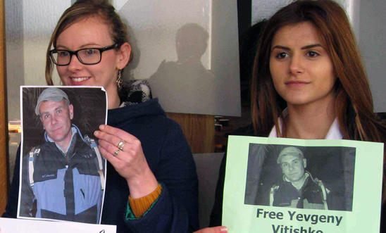 Activists from Amnesty Chelmsford hold photos of Yvgeny