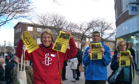 Amnesty members at a 'flash mob' action in Exeter