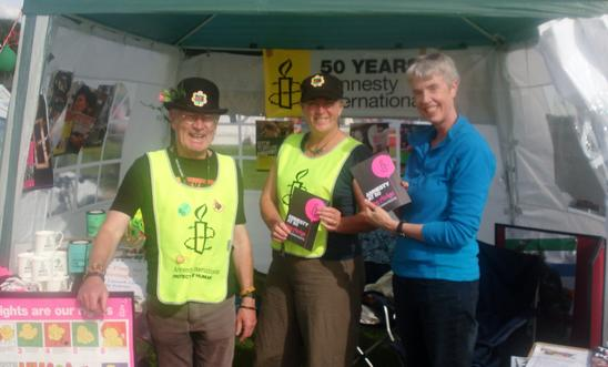 Colour photo of 3 of us on our stand at Shrewsbury Folk Festival