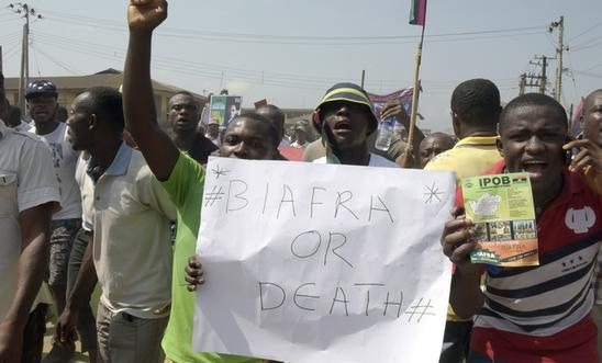 Pro-Biafra supporters hold a placard as they march through the streets of Aba, s
