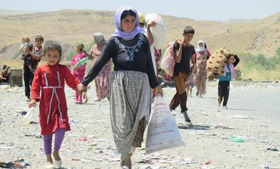 Yezidis fleeing Islamic State fighters