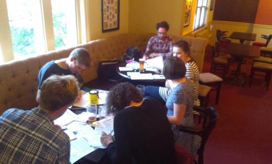 Sheffield Amnesty activists writing letters in July