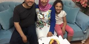 Taner Kılıç, the Chair of Amnesty Turkey, with his wife and daughter, before his arrest