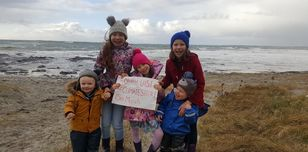 Image shows five young Amnesty activists from the Western Isles on the beach.