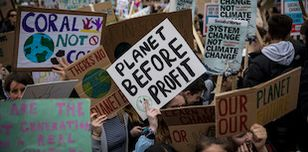 Youth climate strikers demonstrate in the streets of London, calling for urgent climate action