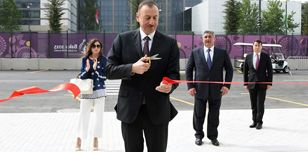 Azerbaijan's President Ilham Aliyev cuts the ribbon to open a venue at the Games