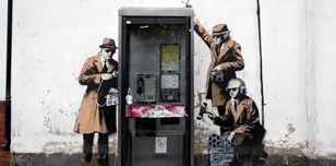 Alleged Banksy street art - spies around a telephone box (Matt Cardy/Getty)