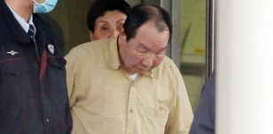 Hakamada is released from a Tokyo detention center on March 27 2014 - AFP/Getty