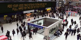 Boards at Waterloo station London ask commuters to help prisoners of conscience
