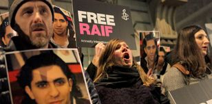 Protesters outside the Saudi Embassy ask Saudi Arabia to free Raif Badawi
