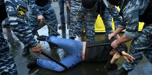 Russian police beat a protester at Moscow's 'March of Millions', May 2012