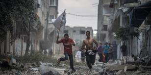 Rescue workers enter Shuja'iyya, Gaza