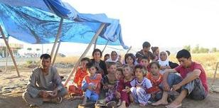 Displaced family who fled Sinjar Mountain in Iraq