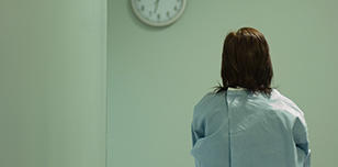 Female patient watches clock