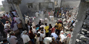 Yemenis gather amidst the rubble at a detention centre hit by Saudi-led coalition air strikes in al-Zaidia district of the Red Sea port city of Hodeidah, on October 30, 2016.