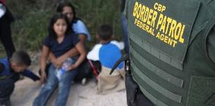 Border Patrol Agents Detain Migrants Near US-Mexico Border (Photo by John Moore/Getty Images)