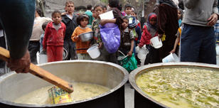Vats of soup in Yarmouk camp, Syria