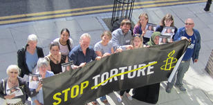 Amnesty trainers demonstrating Stop Torture 2014