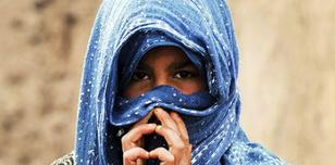 An Afghan woman wearing a head scarf.
