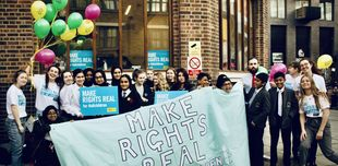 Young people from the Children's Human Rights Network hold up banners calling for their rights to be heard.