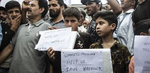 Lift the lockdown in Kashmir: protests stand together with signs saying they're unable to speak to loved ones.