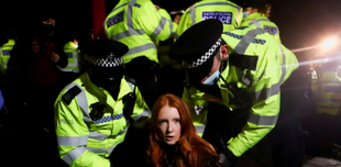 Woman being arrested by the UK police