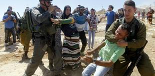 Violent struggle between Palestinian man and Israeli officials