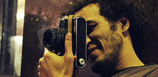 Shawkan taking a picture