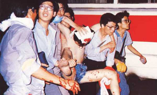 Doctors carry an injured protester to safety on 5 June C. Memo64