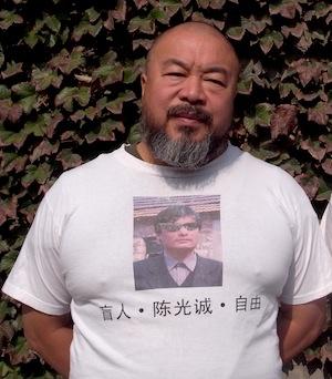 Artist Ai Wei Wei wears a 'free Chen GUangcheng' t-shirt