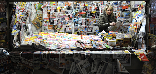 A Russian vendor sells newspapers and magazines in Moscow on 3 March 2010. AFP PHOTO / NATALIA KOLESNIKOVA
