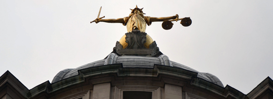 Justice statue on the Old Bailey in London, by bensutherland on Flickr, used under Creative Commons license