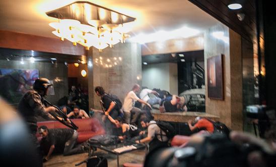 Armed police storm a São Paulo hotel lobby and spray tear gas on 25 January 2014