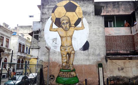 Graffiti in Rio de Janeiro by Captain Borderline, depicting Rafael Braga Vieira as the World Cup trophy