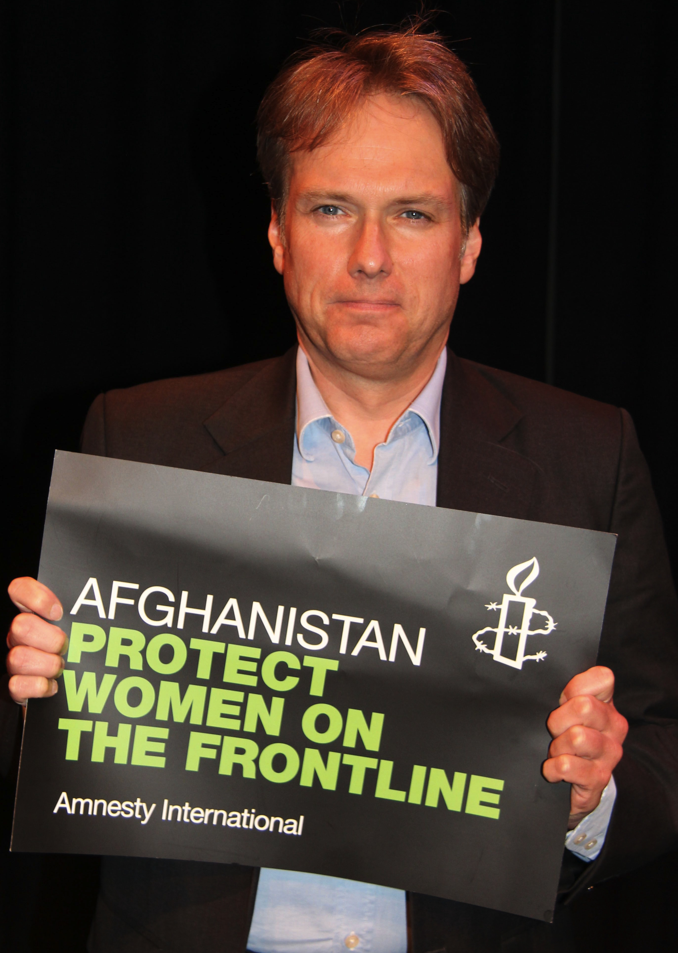 Crawley MP holds Afghan women placard