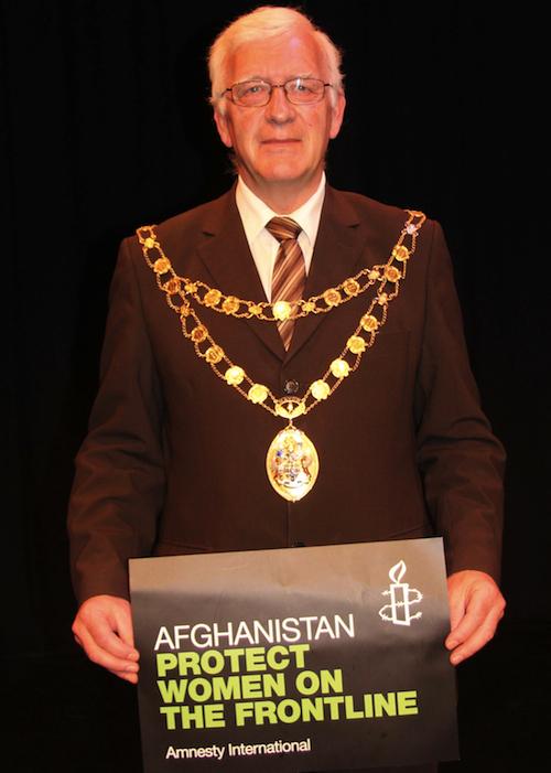 Crawley Mayor holds Afghan women placard