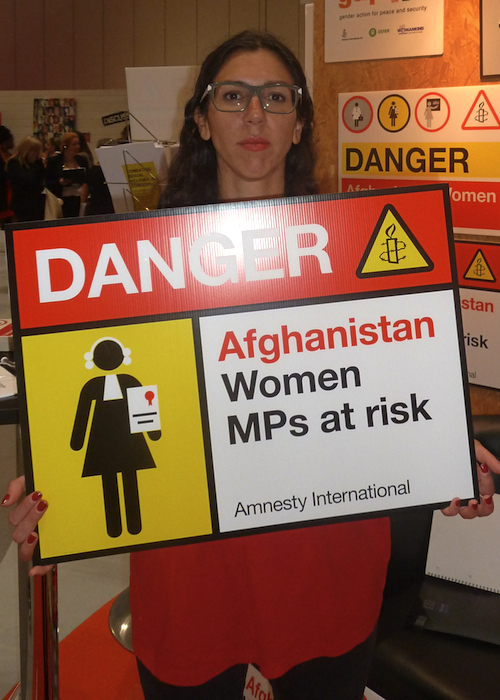 An activist holds a placard at the ESVI summit in London in June 2014
